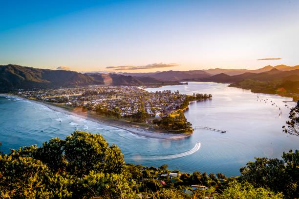 Pauanui Beach and town views from Mount Paku Coromandel New Zealand at sunset stock photo