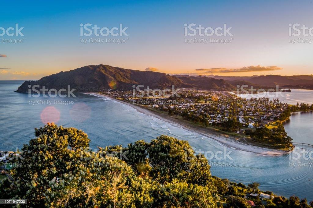 Pauanui Beach and town views from Mount Paku Coromandel New Zealand at sunset stock photo