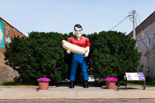 Atlanta, Illinois, USA - July 5, 2014: The Paul Bunyan holding an hot dog statue in the US Route 66 in Atlanta, Illinois, USA