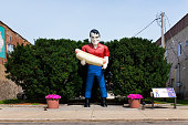 Paul Bunyan holding an hot dog statue in the US Route 66 in Atlanta, Illinois, USA