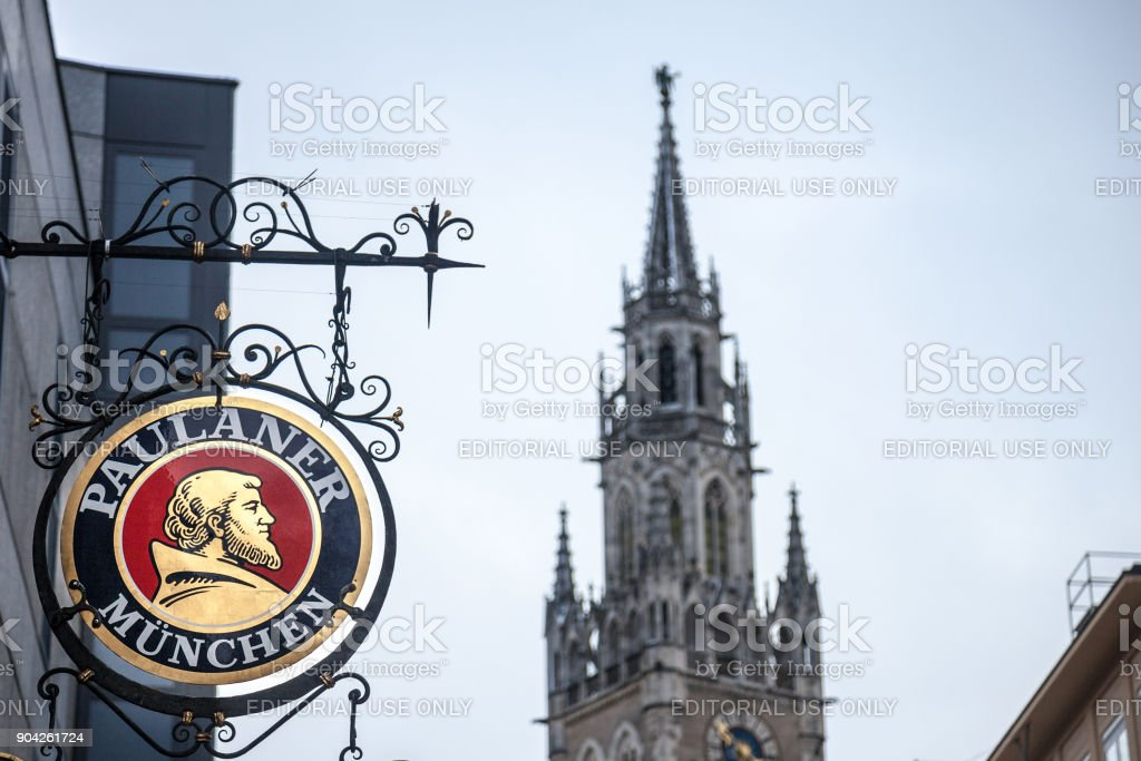 Paulaner Beer logo in front of Munich New Town Hall (Neues Rathaus). Paulaner Bier is one of the symbols and main beers of Munich and Bavaria stock photo