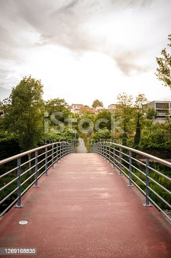 Paved and convex pedestrian bridge located in the city of Chaves in Portugal.