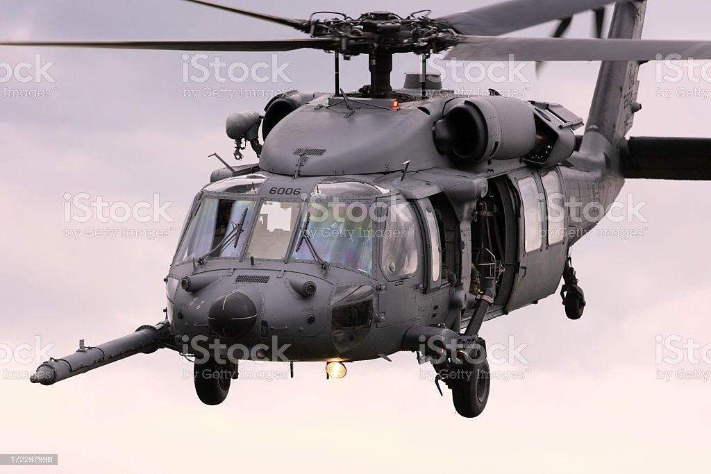 PaveHawk helicopter in flight in a gray sky stock photo