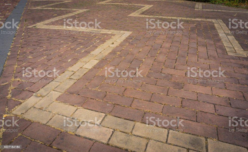 pavement brick pattern close up with zigzag stock photo