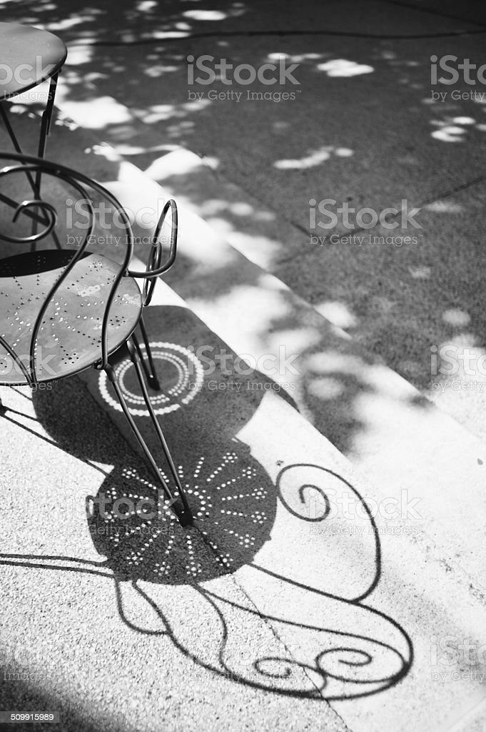 Pavement cafe light and shadow, Provence, France stock photo