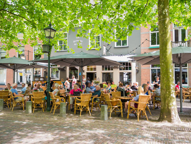 Pavement cafe with people in Wijk bij Duurstede, Netherlands stock photo