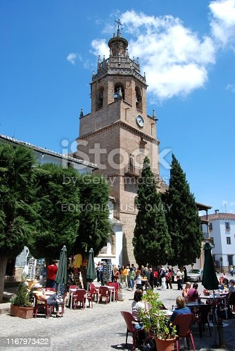 Front view of Santa Maria La Mayor Church with pavement cafes in the foreground, Ronda, Malaga Province, Andalucia, Spain, Europe.