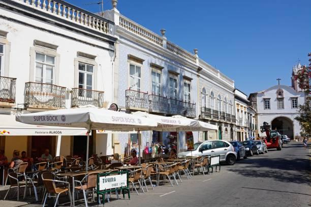 pavement cafes in the town centre, tavira, portugal. - esplanada portugal imagens e fotografias de stock
