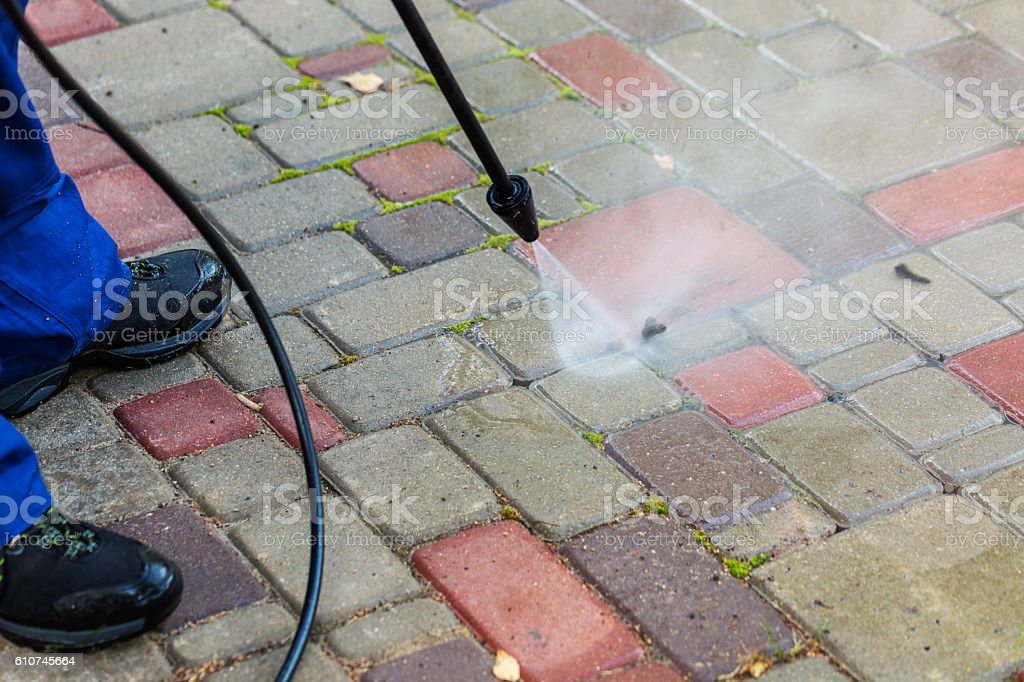 pavement cleaning with high pressure washer stock photo