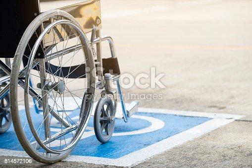 istock Pavement handicap symbol and wheelchair 814572106