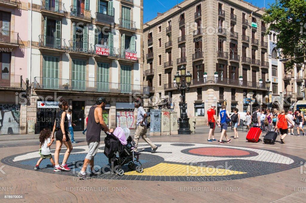 Pavement mosaic by Joan Miro on la Rambla in Barcelona, Spain stock photo