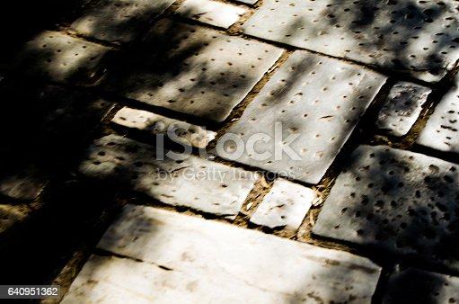 Texture of a pavement. Sunlight effect.