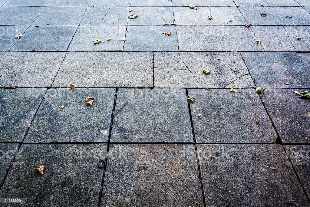 Pavement texture with fallen leaves - abstract background stock photo