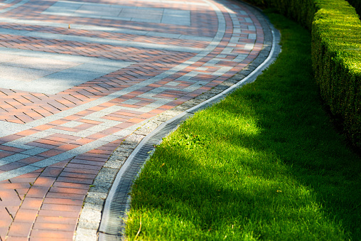 Pavement tile and shorn grass in landscape design