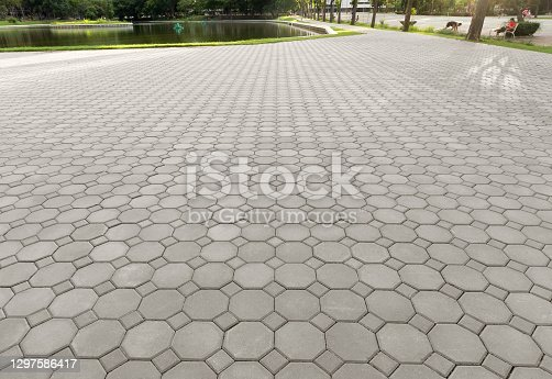 Truncated square tiling pattern of paver brick floor or block paving. Construction or lay on ground at outdoor for road, street, pavement, sidewalk, floor, path, footpath, walkway, patio or background