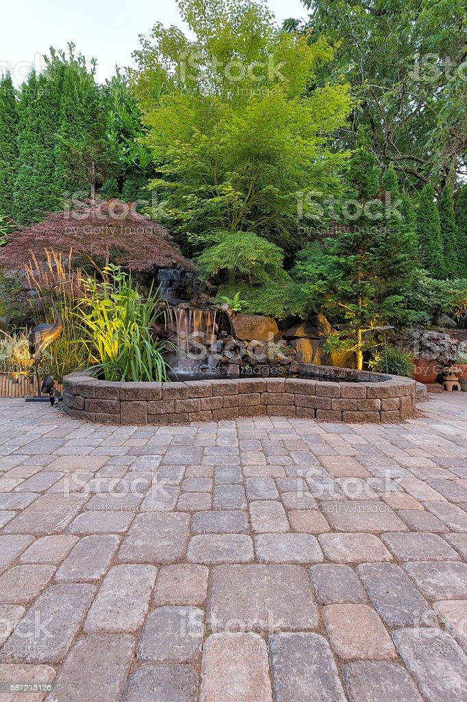Paver Brick Patio with Waterfall Pond stock photo