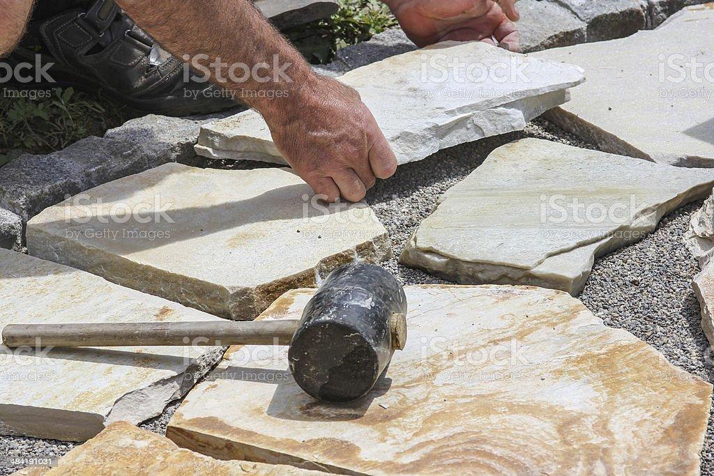 Paver mit Marmor-Gerichte - Lizenzfrei Arbeiten Stock-Foto