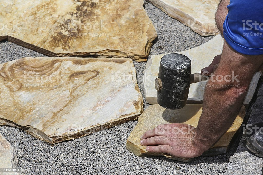 Paver with sledge and marble plates stock photo