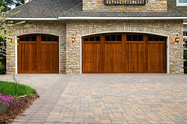Pavers, custom doors, and stone on upscale home. stock photo