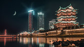 Pavilion of Prince Teng,Tengwangge, Chinese traditional building at moon night, Jiangxi province,Nanchang city ,Shanghai,Beijing ,China