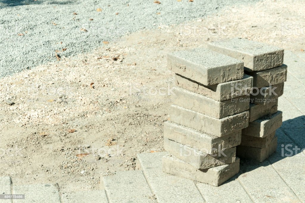 Paving stone on the street pavement reconstruction site stock photo