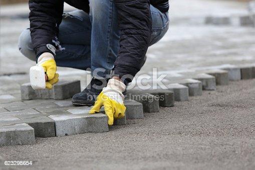 istock Paving stone worker 623298654