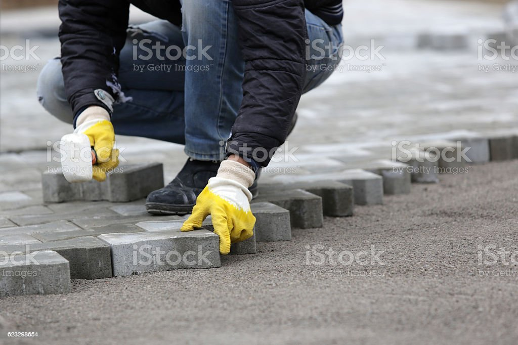 Paving stone worker stock photo