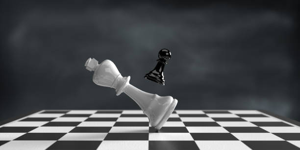 Pawn defeats King on chess board. stock photo