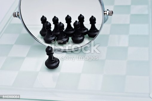 istock A pawn looking in the mirror 846369054