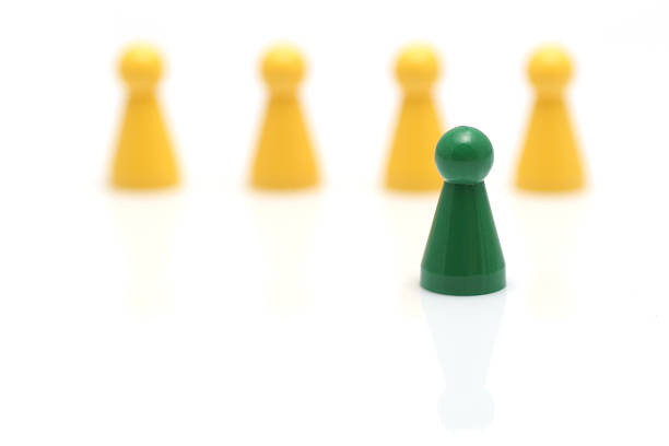 pawn standing out stock photo