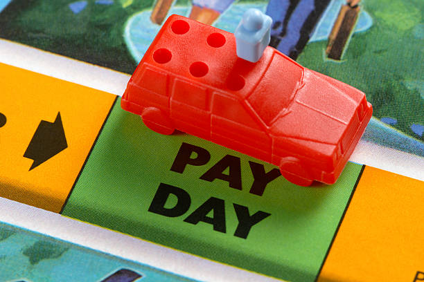 pay day - game of life stock photos and pictures