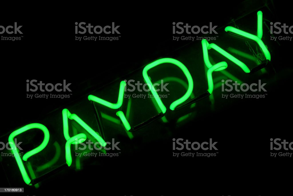 Pay Day Sign in Green Neon on Black stock photo