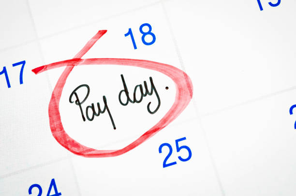 Pay day written with red mark stock photo