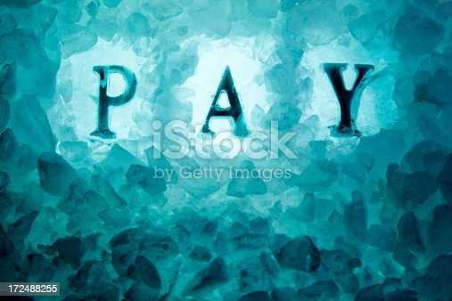 A pay freeze. PAY frozen into ice. Good copy space.
