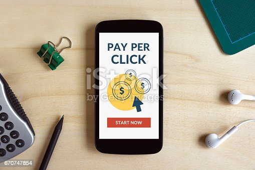 istock Pay Per Click concept on smart phone screen on wooden desk 670747854