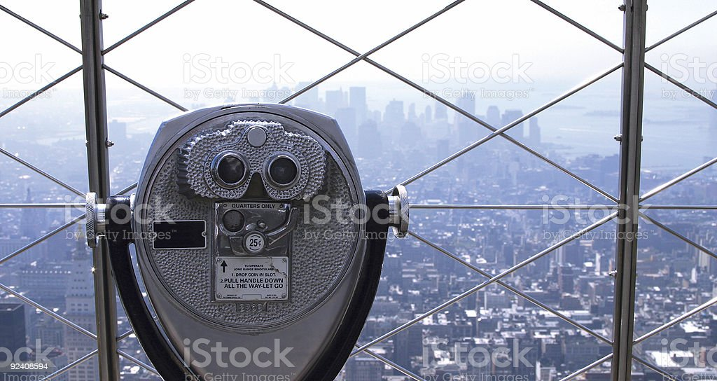 Pay per view telescope overlooking the city royalty-free stock photo
