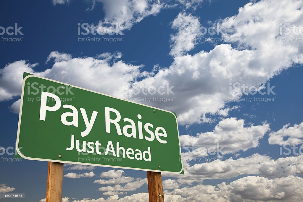Pay Raise Green Road Sign stock photo