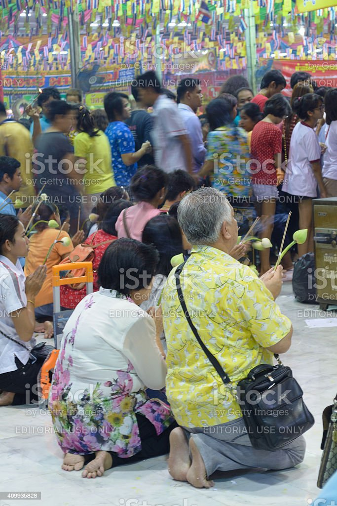 Pay respects to Luang Pho Wat Rai Khing stock photo