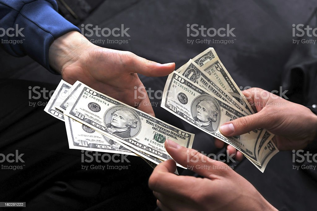 pay someone with dollars stock photo