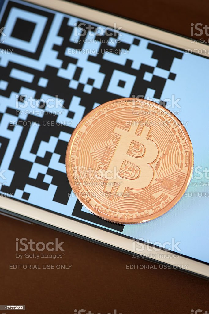Pay with Bitcoin royalty-free stock photo