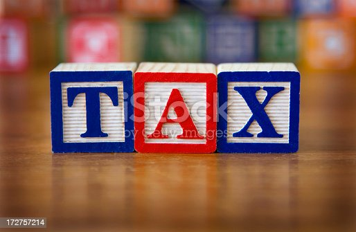 Letters that spell the word tax.