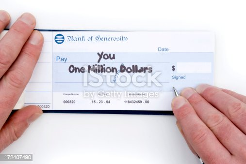 Signing a one million dollar cheque.
