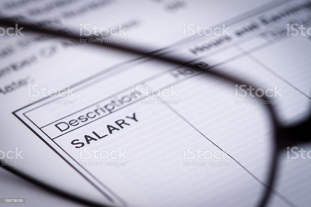 """Paycheck and glasses """"Paycheck and glasses with selective focus on a word """"""""salary"""""""".    """" Business Stock Photo"""