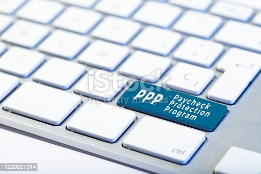 PPP Paycheck Protection Program concept. Inscription on Keyboard Key and hand with protective glove ready to push the key