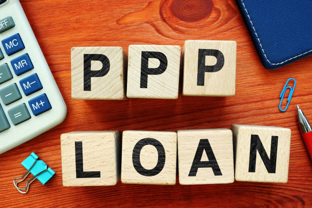 Paycheck Protection Program PPP Loan. Wooden cubes on the desk. Paycheck Protection Program PPP Loan. Wooden cubes on the desk. borrowing stock pictures, royalty-free photos & images