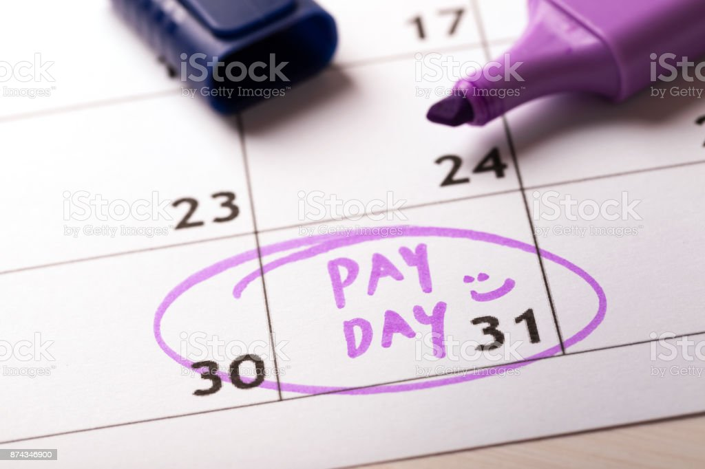 payday concept calendar with marker and circled day of salary stock photo