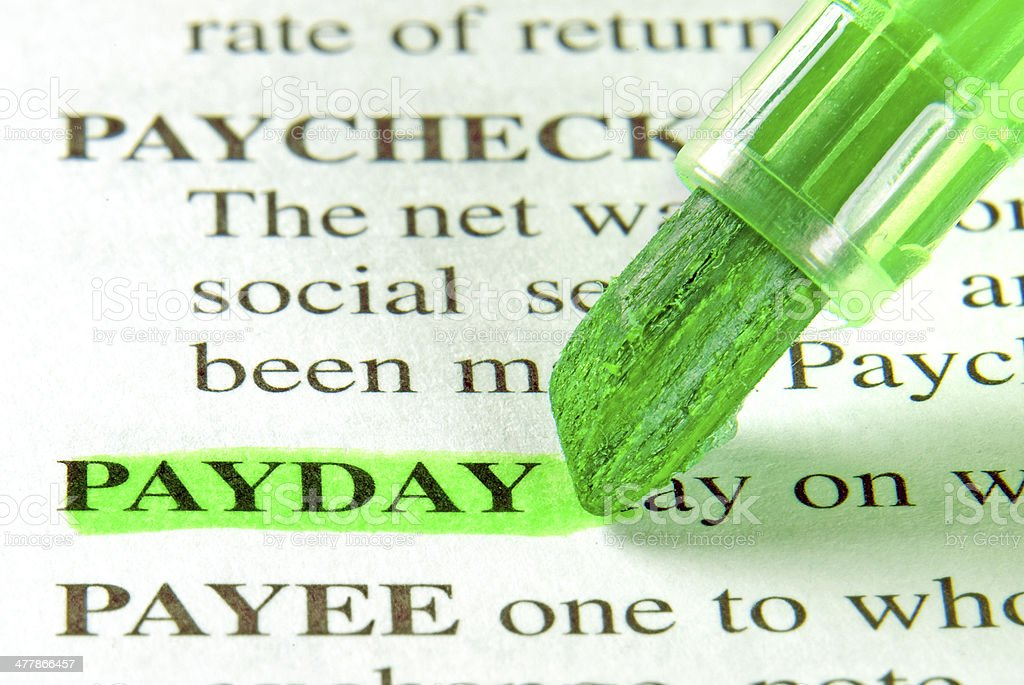 payday definition highligted in dictionary stock photo