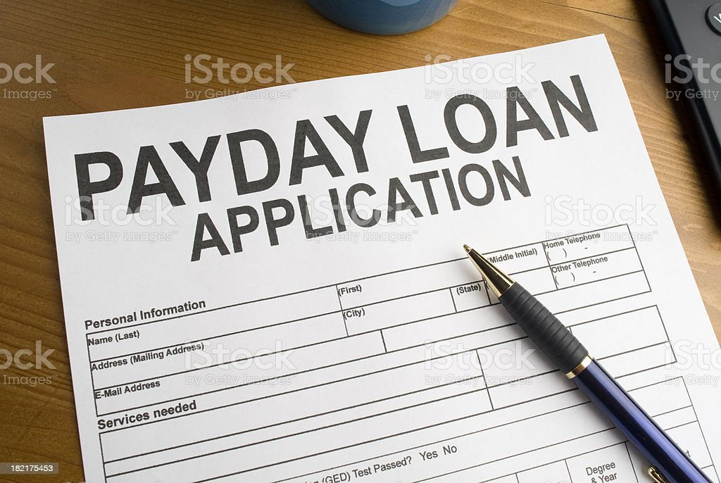 Payday Loan Application on a desk royalty-free stock photo