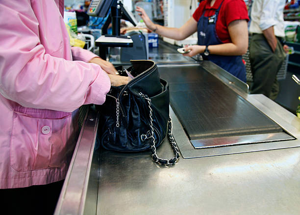 paying at register - conveyor belt stock photos and pictures