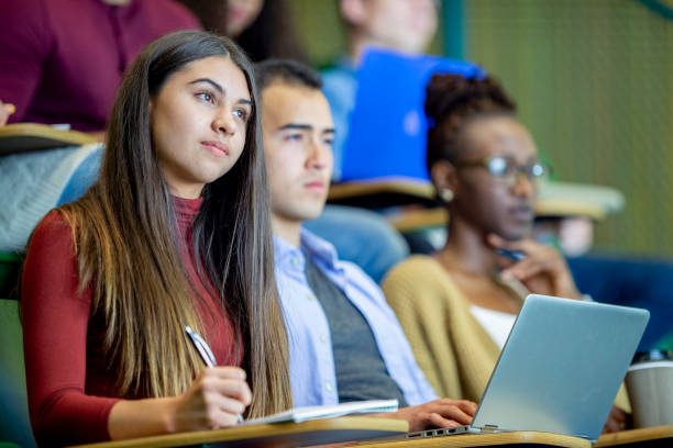 paying attention in class - university students stock photos and pictures